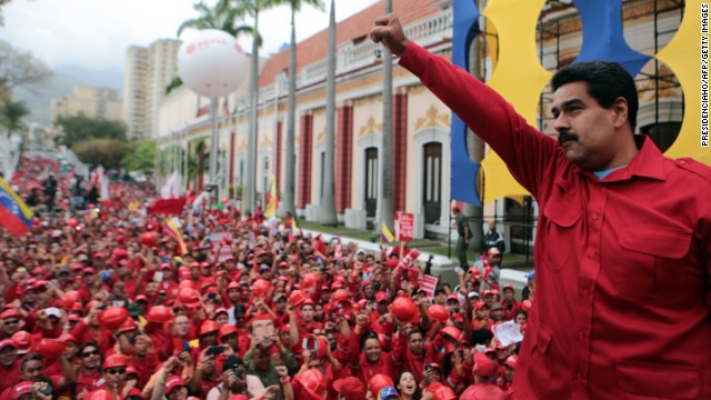 Venezuelan President Nicolas Maduro raises his fist during a rally in Caracas, on February 18, in this photo released by the Venezuelan government.