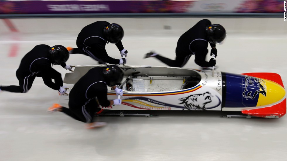 The Romanian four-man bobsled team starts a run during a training session on February 19.