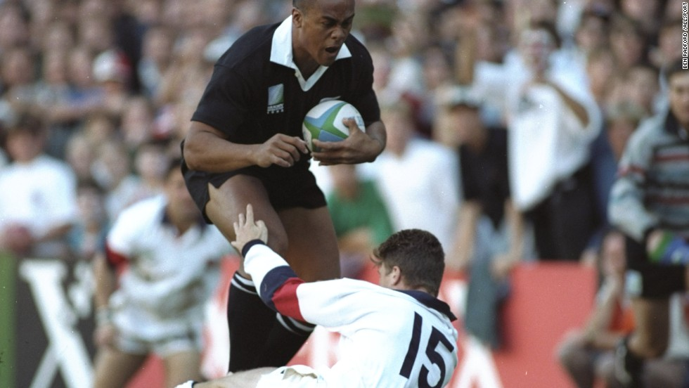 This picture of fullback Mike Catt being trampled over by Lomu summed up the helplessness of England's players in the face of the warrior All Black. New Zealand won the game 45-29 but lost to South Africa in the final.