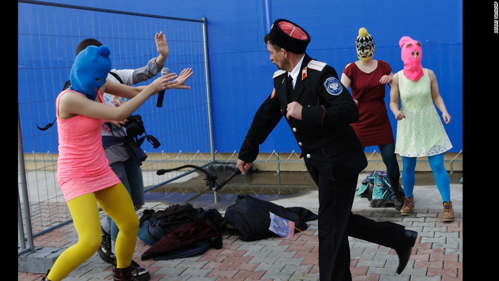A video appeared to show security officials beating two members of the punk rock protest band Pussy Riot. Two members were held by police just miles from the Olympic Park.