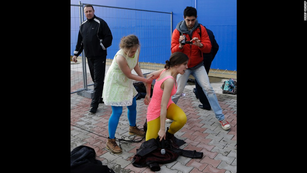 Band member Maria Alyokhina helps up Tolokonnikova on February 19. A day earlier, members of the band as well as journalists and Russian human rights activists were detained for several hours at a police station.
