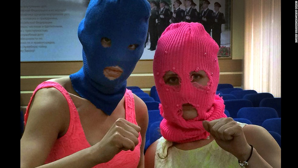 From left, Tolokonnikova and Alyokhina pose for a photo in the police station after their arrest on February 18.