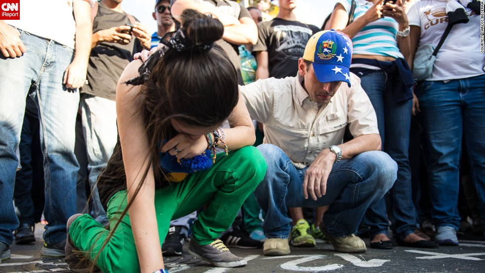 "A young <a href=""http://ireport.cnn.com/docs/DOC-1084811"">woman cries</a> on February 13 at the spot where an opposition member was killed a day before in Caracas."