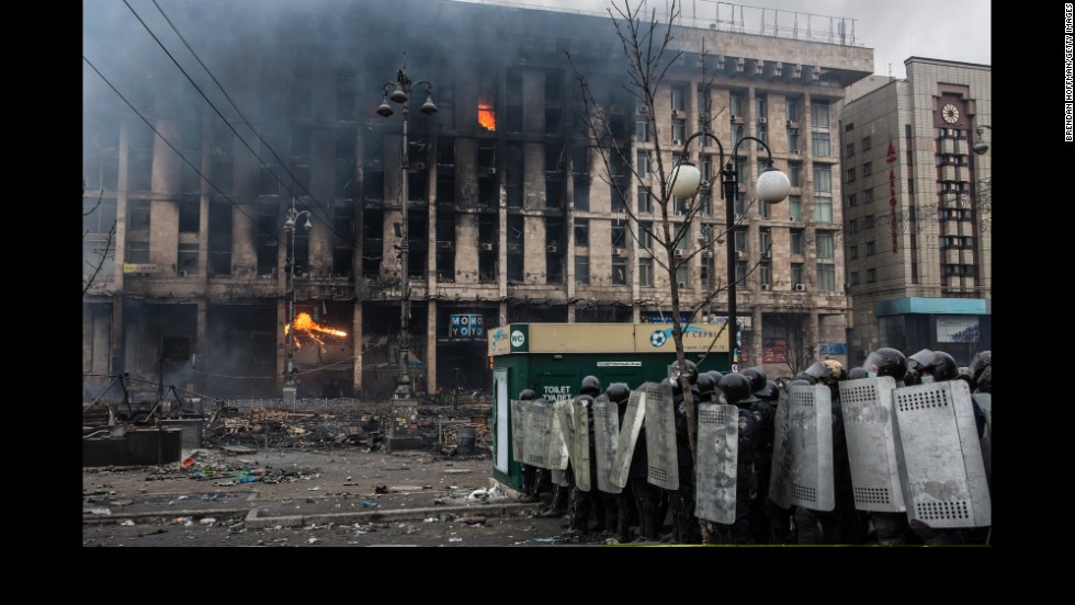 Police form a line as the Trade Unions Building burns in Independence Square on February 19.