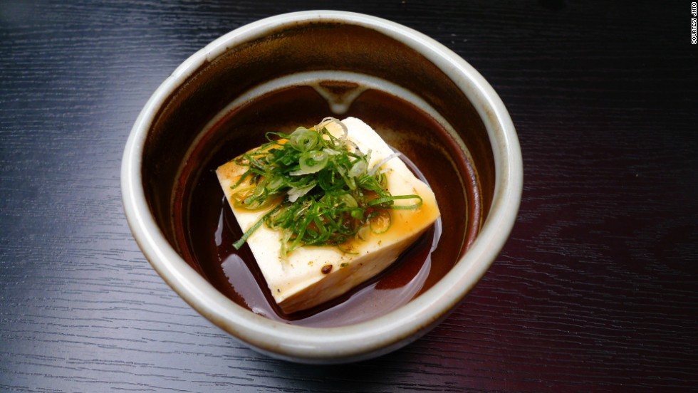 "Kyoto cuisine is a draw, as well. Yudofu (""boiled tofu"") is a specialty. The stew-like hot pot is made by simmering tofu and vegetables in a kelp-based broth. A popular place to eat it is the area around Nanzen-ji, where locals refer to the dish as Nanzen-ji-dofu."