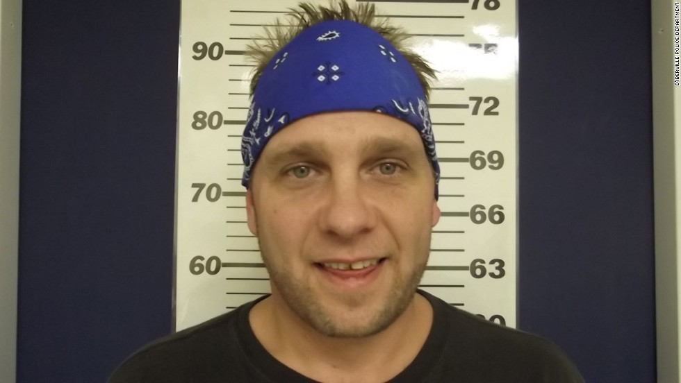 "3 Doors Down bassist Todd Harrell smiles for his mugshot after being <a href=""http://www.cnn.com/2014/02/19/showbiz/three-doors-down-bassist-charged/index.html"">charged with driving under the influence</a>. He joins the club of other smiling celebs:"