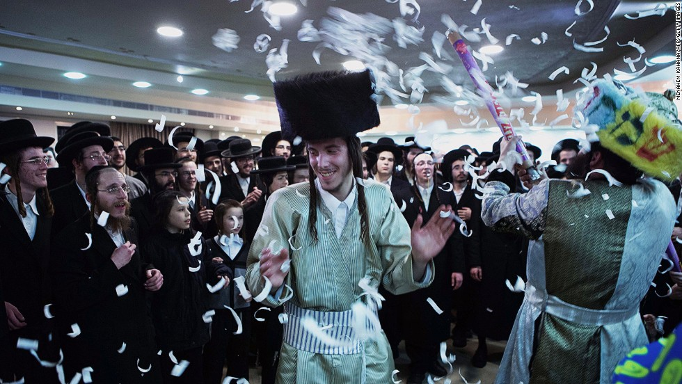 FEBRUARY 19 - JERUSALEM, ISRAEL: Ultra-Orthodox Jewish groom Aharon Krois celebrates his wedding with Rivka Hannah Hofman (not pictured) during the Mitzvah Tantz on February 18. During the ritual the bride will dance with members of the community, family and with her groom at the end of the wedding ceremony.