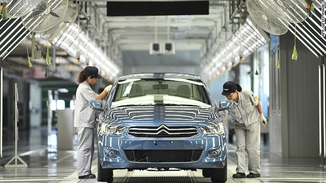 (FILES) This file picture taken on July 2, 2013 shows employees working on a production line in a new plant of Dongfeng Peugeot-Citroën Automobile Limited (DPCA) in Wuhan, central China's Hubei province. French carmaker Peugeot posted a net loss of 2.3 billion euros on February 19, 2014 as it announced a tie-up with China's Dongfeng and the French state that is expected to boost its capital by 3 billion euros. AFP PHOTO == CHINA OUT==AFP/AFP/Getty Images