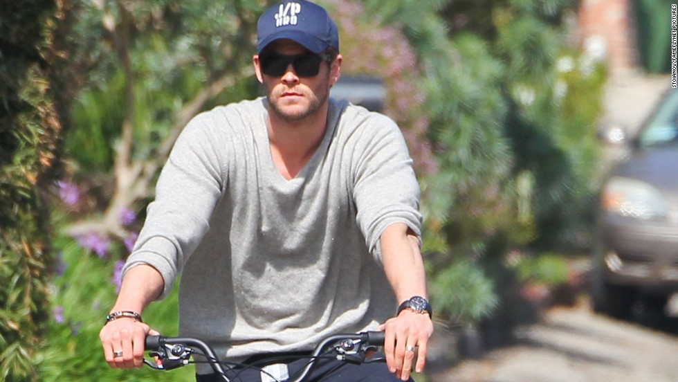 Actor Chris Hemsworth takes his daughter India out for a bicycle ride in Malibu, California on February 19.