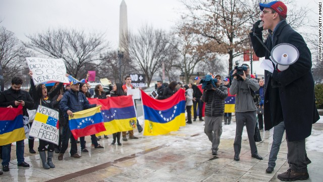 Protesters chant in opposition of the Venezuelan government in front of the Organization of American States (OAS) in Washington, DC, February 19, 2014. The oil market was buoyed Wednesday by hopes of strong heating fuel demand in the winter-struck United States, alongside simmering tensions in Africa and Venezuela. AFP PHOTO / Jim WATSON (Photo credit should read JIM WATSON/AFP/Getty Images)