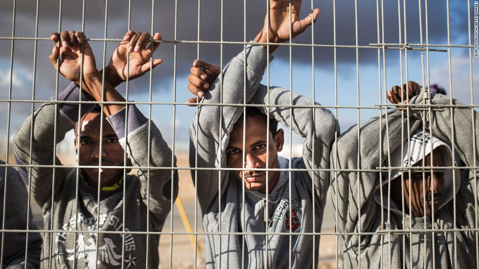 Asylum seekers take part in a day of protest on February 17 at the Holot detention center, where hundreds of migrants are being held in the southern Negev desert of Israel.