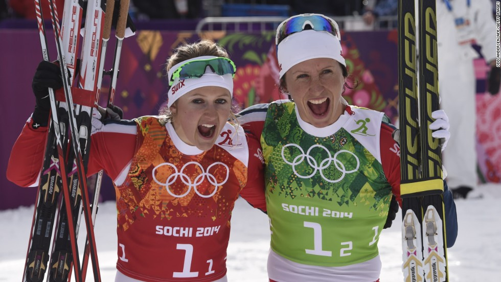 Norway also won the women's cross country team sprint, with Marit Bjoergen (right) claiming her second gold of the games alongside Ingvild Flugstad Oestberg.