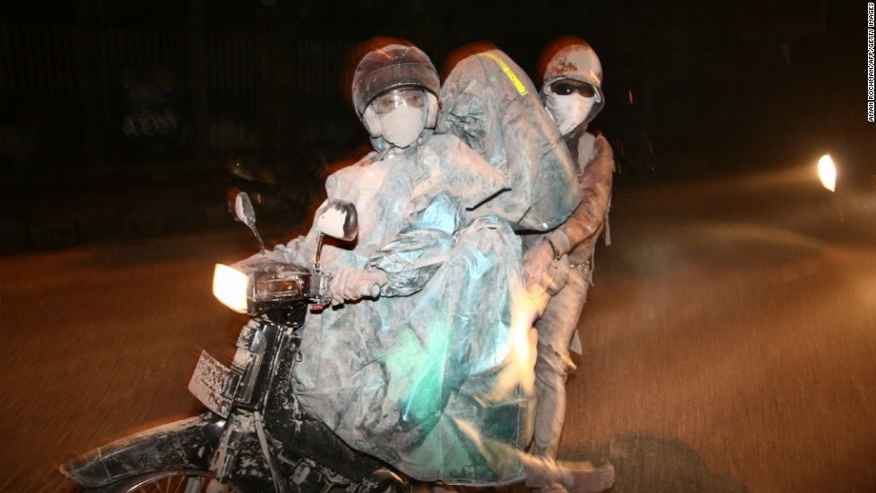 "Residents evacuate to a safe place after <a href=""http://www.cnn.com/2014/02/13/world/asia/indonesia-volcano-eruption-evacuation/index.html"">Mount Kelud erupted</a> in Malang, Indonesia, on February 14. At least three people were killed and tens of thousands more were forced out of their homes."