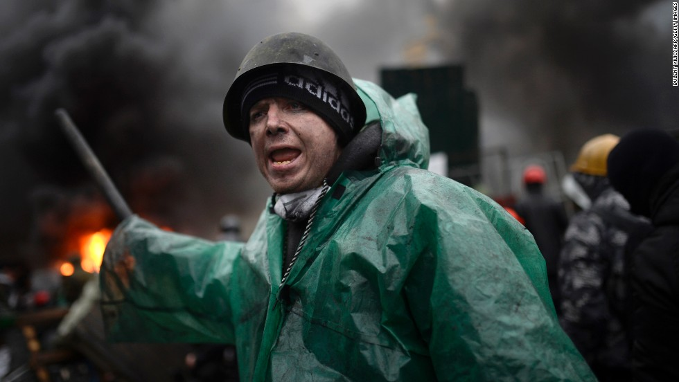 A protester shouts during clashes with police on February 20.