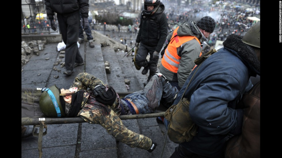 An injured demonstrator is carried away from Independence Square on February 20.