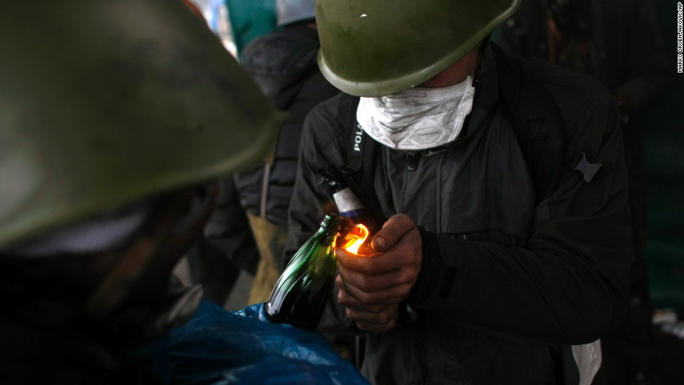Protesters light Molotov cocktails in Kiev on February 20.