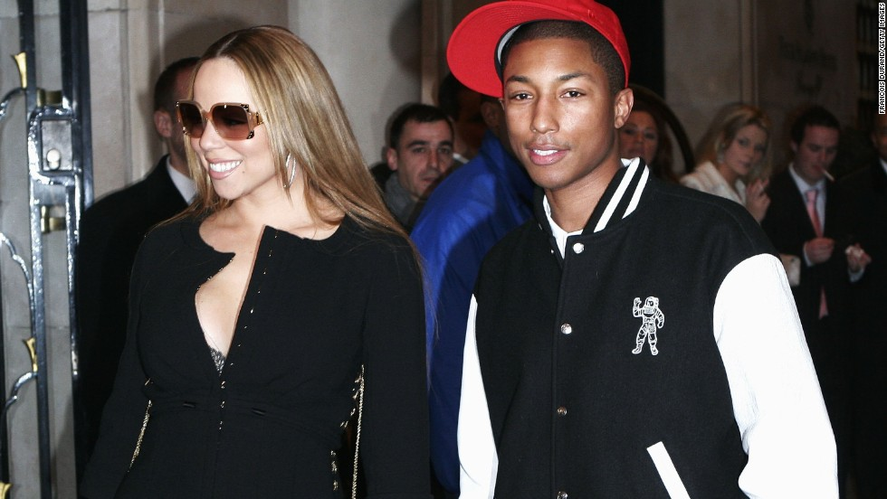 "We'd have a glow, too, if we hung out with Mariah Carey, as Pharrell did in Paris in March 2006. The pair were shooting scenes for a music video to go with their single, ""Say Somethin.'"""