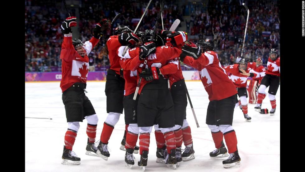 The women's hockey team from Canada celebrates Thursday, February 20, after Marie-Philip Poulin scored the game-winning goal in overtime to defeat the United States and win the gold medal.