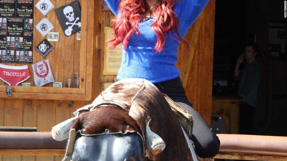 "Snooki goes for a ride on the set of ""Extra!"" on February 19."