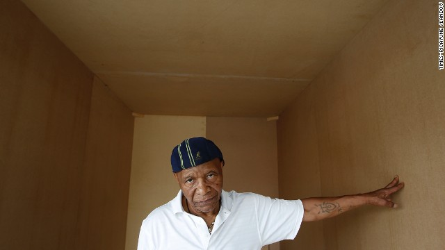 Robert King stands in a wooden replica of his 6x9x12 cell by artist Jackie Sumell in April 2011.