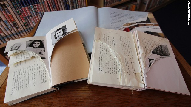 Ripped copies of Anne Frank's diary and related books at Shinjuku City Library in Tokyo on February 21, 2014.