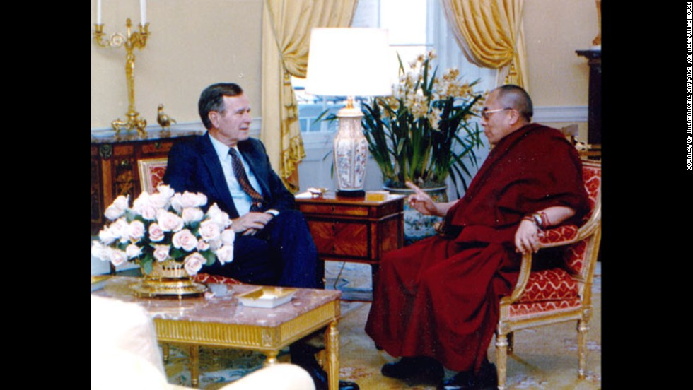 President George H. W. Bush meets with the Dalai Lama at the White House in April 1991. It was the first-ever meeting between the Tibetan spiritual leader and a U.S. president.