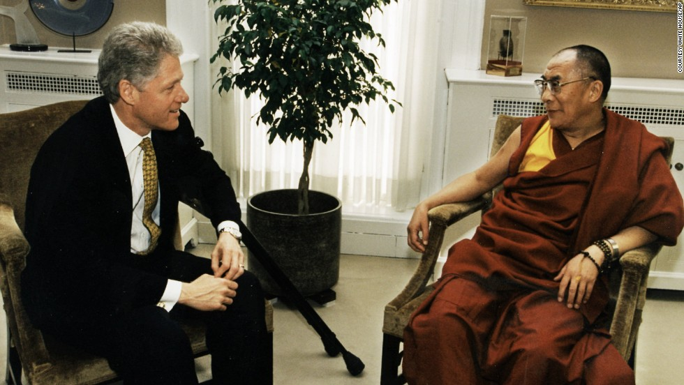 The Dalai Lama meets with President Bill Clinton at the White House.