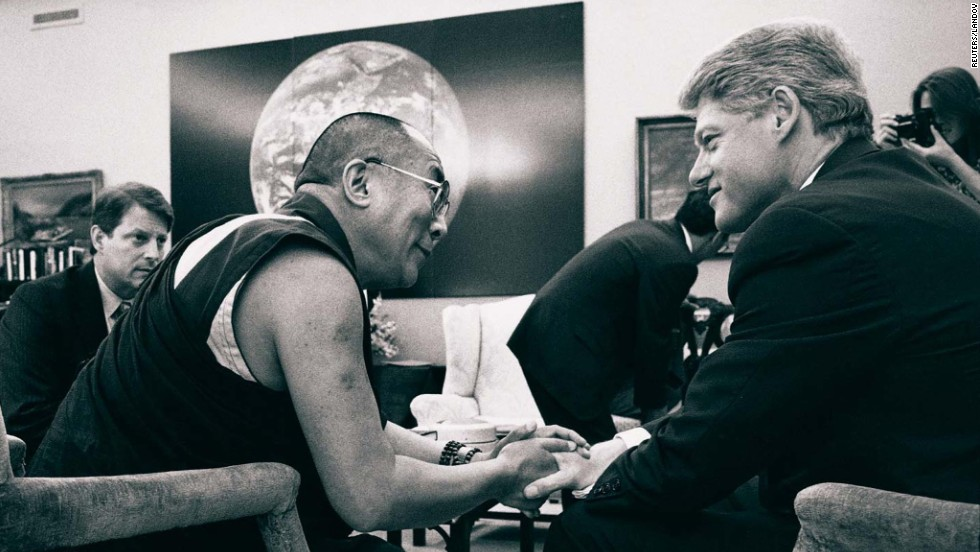 President Bill Clinton talks with the Dalai Lama as Vice President Al Gore looks on during a meeting at the White House in April 1994.