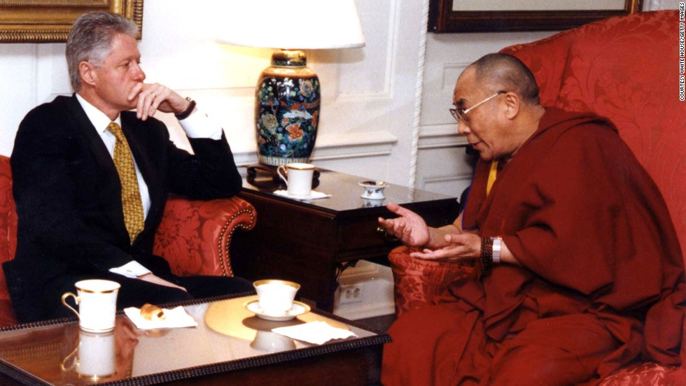 President Bill Clinton listens to the Dalai Lama during a meeting in November 1998 at the White House.