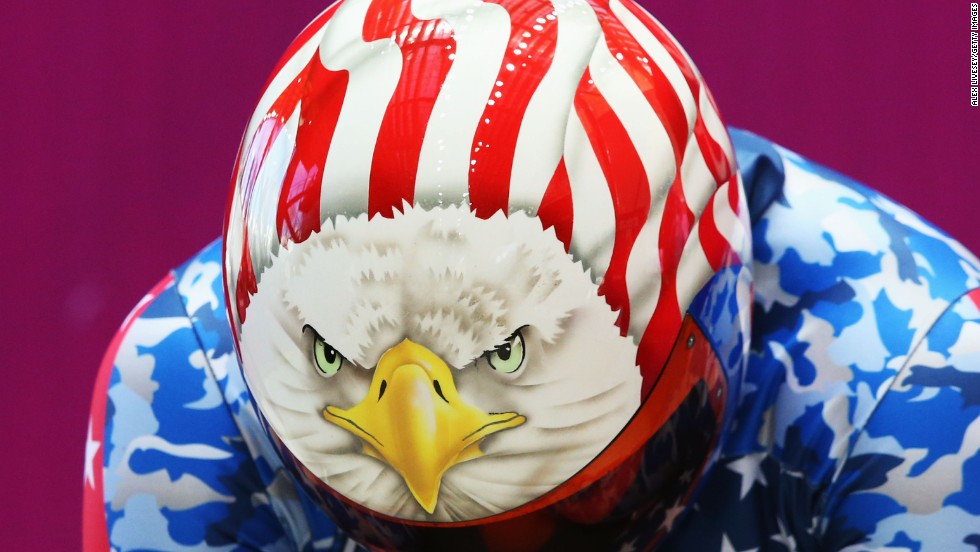 Katie Uhlaender of the United States shows a bald eagle design on her helmet before her skeleton training run.
