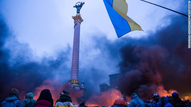 Anti-government stand behind a 'wall of smoke' during clashes with police in the center of Kiev on February 20, 2014.