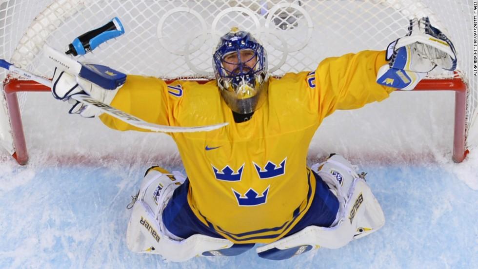 Swedish goaltender Henrik Lundqvist celebrates his team's win against Finland in the hockey semifinals on February 21.