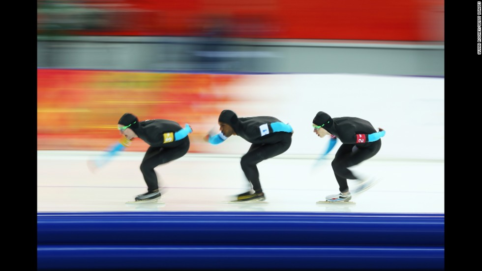 From left, American speedskaters Jonathan Kuck, Shani Davis and Brian Hansen compete in the men's team pursuit on February 21.