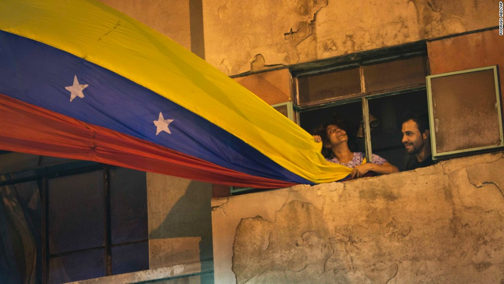 A woman waves a Venezuelan flag out of her Caracas window on February 21.