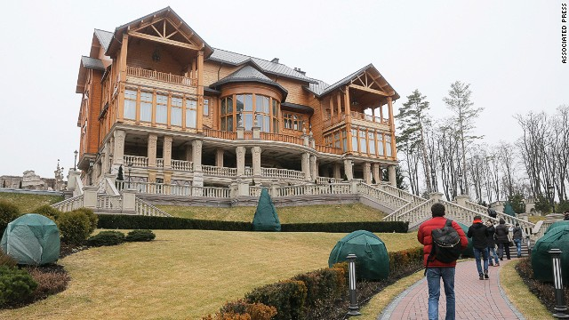People walk around the Ukrainian presidential estate in a suburb of Kiev on Saturday, February 22, after President Viktor Yanukovych left the capital.