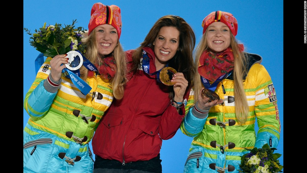Anke Karstens of Germany (silver), Julia Dujmovits of Austria (gold) and Amelie Kober of Germany (bronze) show off their ladies' parallel slalom medals on February 22.