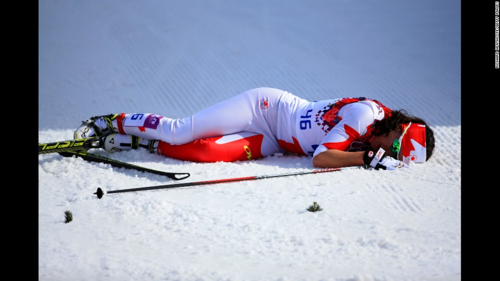 Emily Nishikawa of Canada collapses after the women's 30-kilometer mass start free cross-country event on February 22.