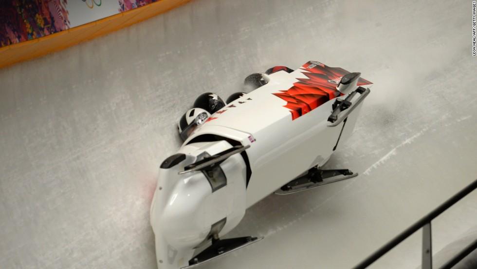 Canada's four-man bobsleigh team, made up of pilot Justin Kripps, pushman Jesse Lumsden, pushman Cody Sorensen and brakeman Ben Coakwell, crashes during a heat Saturday, February 22.