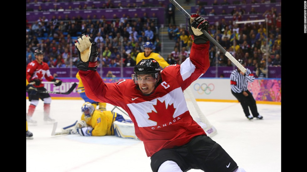 "Sidney Crosby celebrates after scoring Canada's second goal during the men's ice hockey gold medal match against Sweden on Sunday, February 23. Most of us know the Winter Olympics through the power of television, as a spectacle in constant motion. Seeing the Games through still photography is a different experience altogether. Here's a look at the most compelling images from the word's best photographers at Sochi 2014. | <em>More photos:</em> <a href=""http://www.cnn.com/2014/02/08/worldsport/gallery/falling-down-in-sochi/index.html""><em>Falling down in Sochi </a></em>"