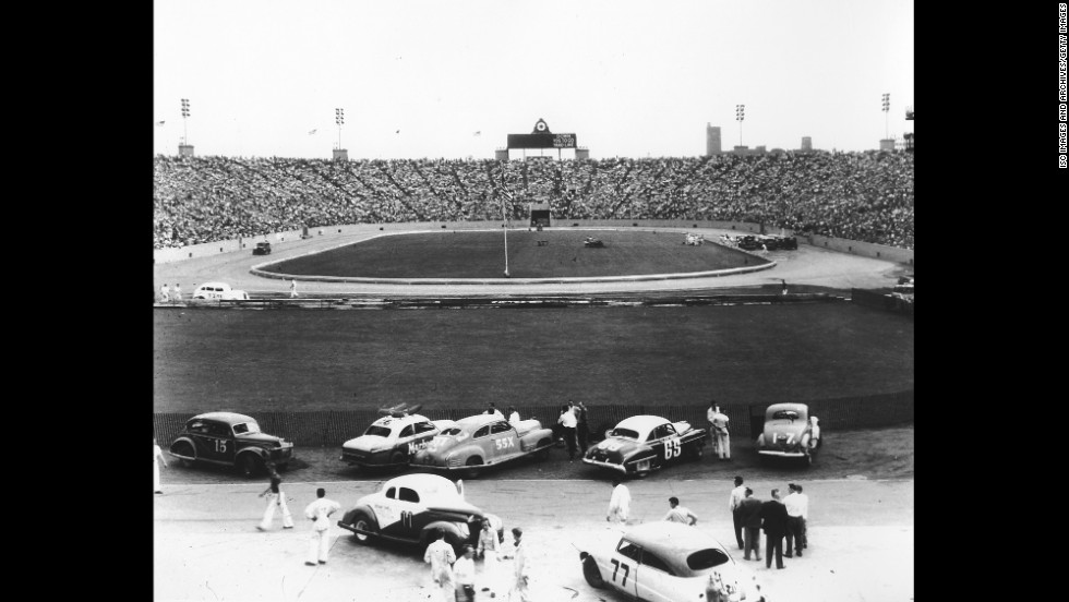 Cars prepare to race at Soldier Field. The stadium, on Chicago's South Side, first opened in 1924 and is still the home of the Chicago Bears today.
