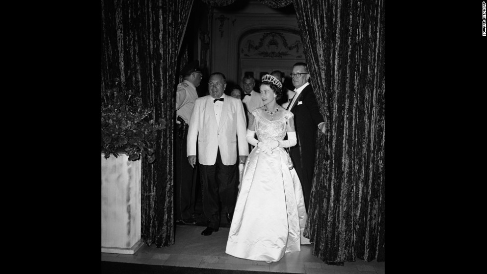 Queen Elizabeth II enters the Grand Ballroom of the Hilton Hotel in Chicago on July 6, 1959. She was attending a banquet held by Chicago Mayor Richard J. Daley, seen at left in the bow tie. Daley and his son, Richard M. Daley, presided over Chicago as mayor for 42 combined years.