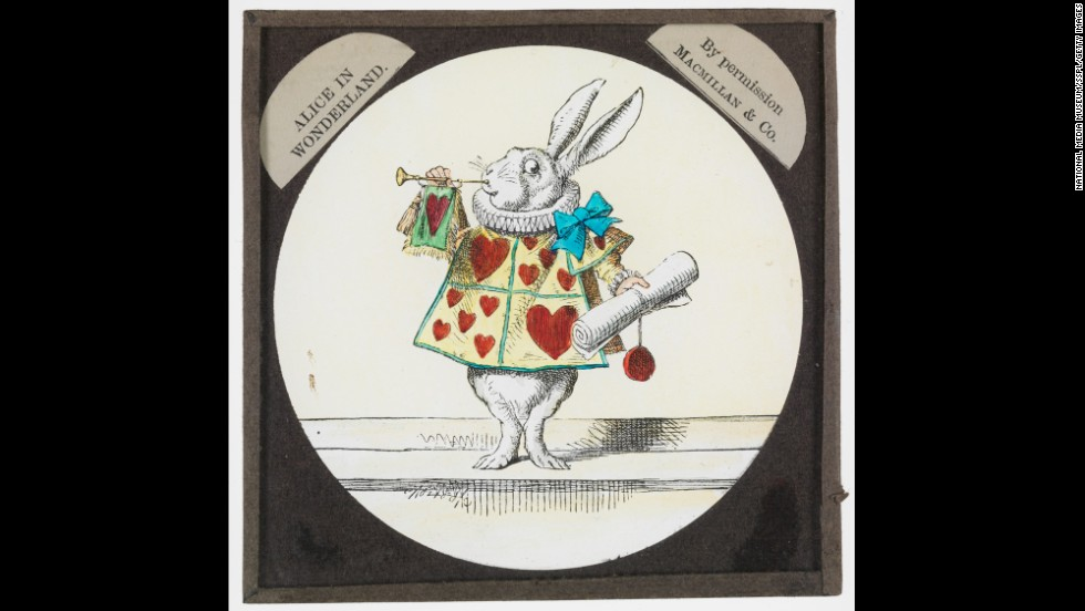 "This slide from ""Alice in Wonderland"" shows the rabbit dressed as a member of the Red Queen's court."