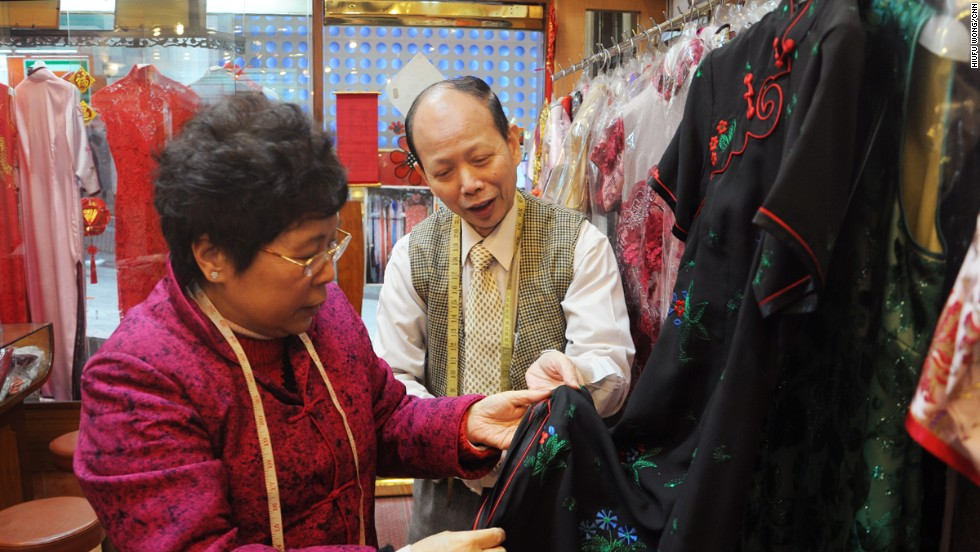 Master tailor Leung Ching-wah (here with wife Joana Fung) suggests longer sleeves for customers conscious of their arms and a higher waistline for those who wish to hide their stomachs.