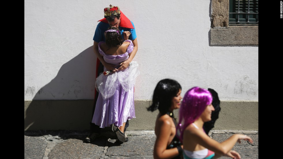 A costumed couple kisses during a pre-carnival celebration in Rio de Janeiro on Sunday, February 23.