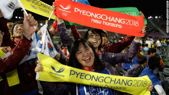 South Koreans celebrate winning the 2018 Winter Olympics at Alpensia Resort on July 7, 2011 in Pyeongchang.