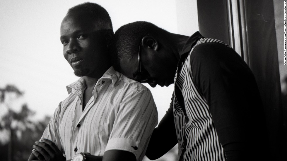 On Monday, Ugandan President Yoweri Museveni signed into law a bill that toughens penalties against gay people and makes some homosexual acts crimes punishable by life in prison. Here, Akram Kalungi, a gay man from Kampala who works in a video store, is pictured with his partner.