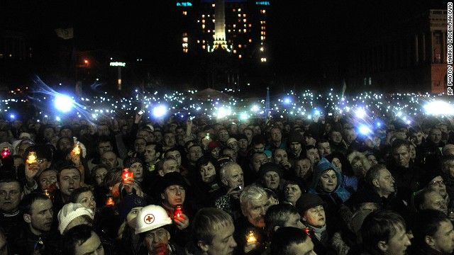 People turn on cell phones and flash lights in Independence Square in Kiev, Ukraine on February 22, 2014.