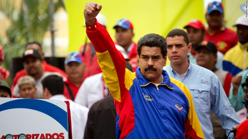 Venezuelan President Nicolas Maduro acknowledges the crowd during a motorcycle rally organized in support of his government February 24 in Caracas.