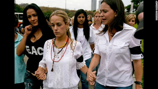 Lilian Tintori, the wife of jailed opposition leader Leopoldo Lopez, center, walks hand in hand with actress Norkys Batista, left, and congresswoman Maria Corina Machado as they arrive for a news conference in Caracas on February 24.