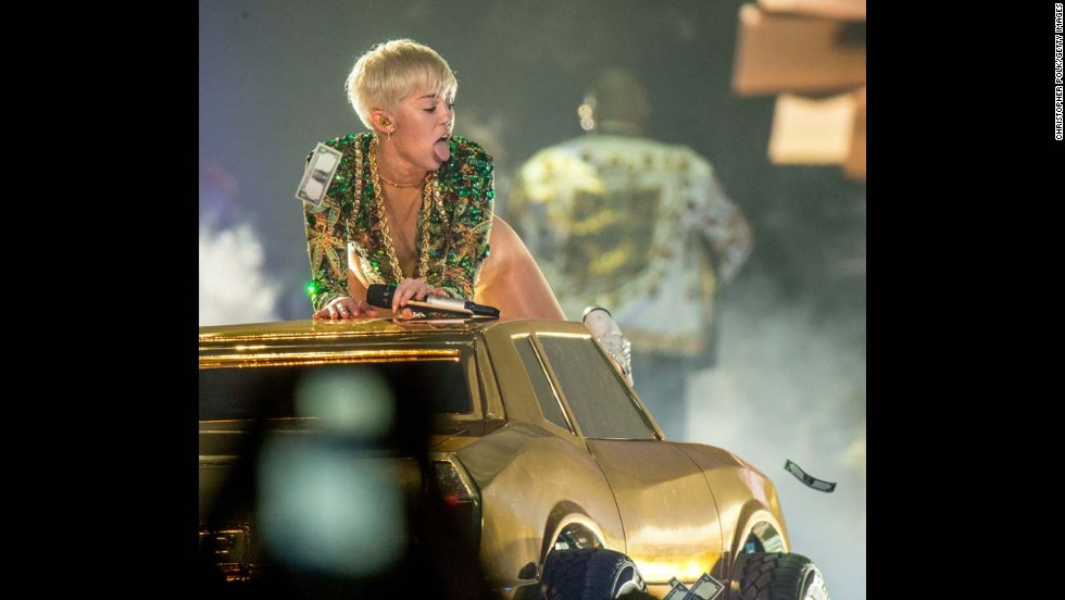 Miley performs a racy number atop a car during her Bangerz Tour at Honda Center on February 20, 2014 in Anaheim, California.